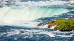 Lake Water Plunging Over Waterfall - stock footage