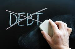 Debt being crossed out and wiped off Stock Photos