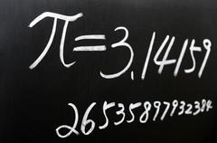 Pi written on a blackboard Stock Photos