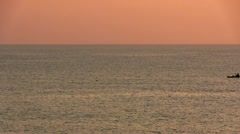 Kayak floating in the sea at dawn Stock Footage