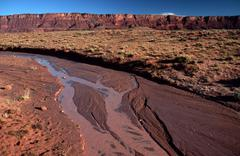 flooded ground echo cliffs navajo indian alt hwy - stock photo