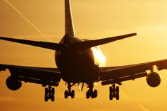Boeing 747 plane sunrise landing - stock photo