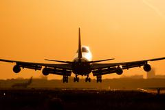 Boeing 747 plane landing - stock photo