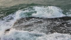 Waves breaking on the rocks, closeup Stock Footage