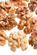few peeled walnut kernels isolated on white background - stock photo