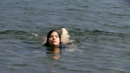 Gorgeous sexy woman getting out of the water Stock Footage