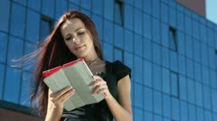 Stock Video Footage of Young Woman with Digital Tablet in Downtown