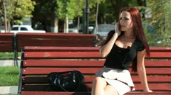 Smiling Woman On The Phone Outdoors Stock Footage