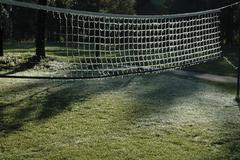 winter frozen volleyball net ice cold geometric - stock photo