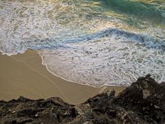 atlantic waves breaking on beach in morning light - stock photo