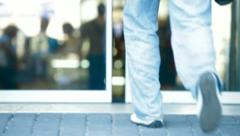 People Walking Through The Glass Doors Stock Footage
