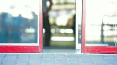 People Walking Through Glass Sliding Doors Stock Footage