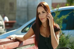 Attractive Woman Answers the Call - stock footage