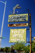 arizona tucson pueblo hotel sign lodging inn - stock photo