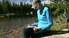 Woman reading kindle Stock Footage