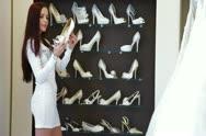 Bride Choosing Wedding Shoes in Bridal Shop Stock Footage