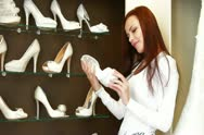 Bride Buying a Wedding Shoes in Bridal Shop Stock Footage