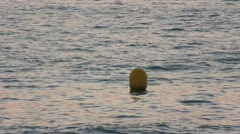 Yellow Buoy bobs on the waves, closeup - stock footage