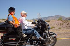 Senior citizen elderly biker harley motorcycle Stock Photos