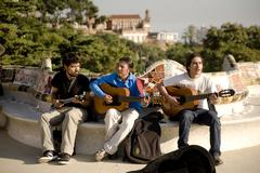 Musicians in Parc Guell in Barcelona. Spain. - stock photo