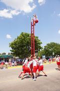 Firemen climbing ladder men males verona day Stock Photos