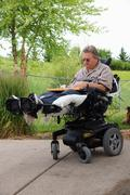 Man male in wheelchair disabled vertical care Stock Photos
