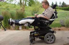 Man male in wheelchair disabled horizontal Stock Photos