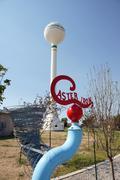 Stock Photo of hand dug well castor iron sculpture water tower