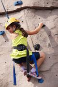 Girl child kid rock climbing indoor climb sport Stock Photos