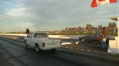 Motorsports, drag race, 1969 Chevy Chevlle SS vs 1980s Chevy mini pick up Stock Footage
