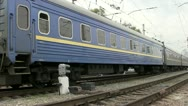 The last car of an old train leaves Stock Footage