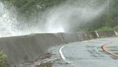 Waves Splash On Sea Wall Road During Storm Stock Footage