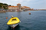 Stock Photo of yellow boat in mediterranean town senj in croatia