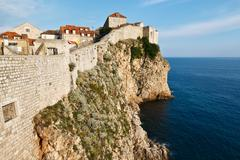 Amazing dubrovnik defensive wall built on cliff, croatia Stock Photos