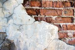 Cracked brick wall Stock Photos