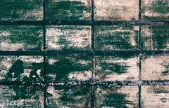 grungy tiled green wall - stock photo