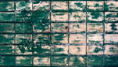 painted green tiled wall - stock photo