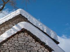 Snow covered old house - stock photo