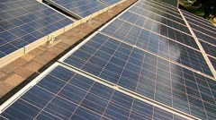 Pan of Solar Panels on roof - stock footage