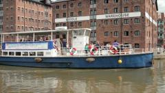 Queen boadicea ii tour boat passes biddle warehouse at the historic glouceste Stock Footage