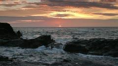 Sea water hitting rocks at sunset, godrevy, cornwall coast Stock Footage