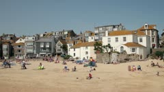 Holidaymakers on the beach at st ives, cornwall, england Stock Footage