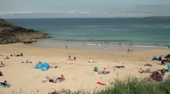 Holidaymakers on the beach at porthgwidden beach, st ives, cornwall Stock Footage