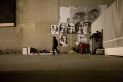 homeless people and street art in Barcelona. Spain. - stock photo