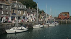 Yachts and tourists in the harbour at padstow, cornwall, england Stock Footage