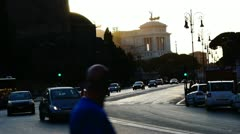 Rome rush-hour traffic Victor Emmanuel Monument and Roman Forum Stock Footage