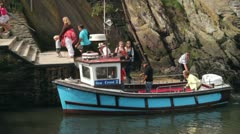 Tourists disembarking boat after taking a boat trip at polperro, cornwall Stock Footage