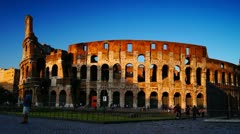 Rome, Arch of Constantine at the Colosseum at sunset Stock Footage