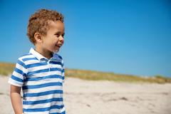 Adorable kid outdoors looking happy Stock Photos