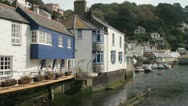 Stock Video Footage of buildings and accommodation at polperro harbour, cornwall, england